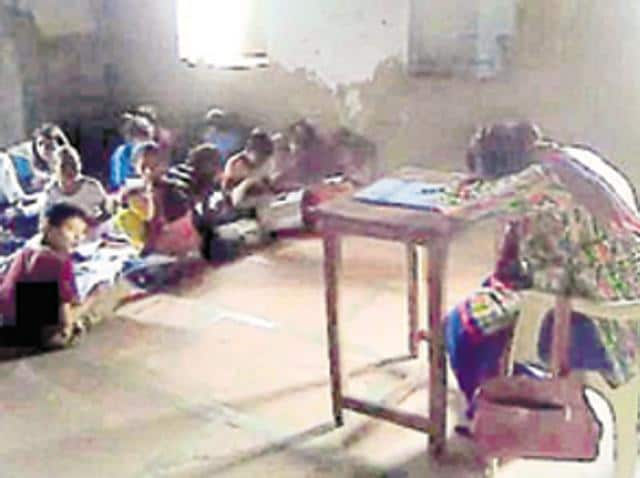 A video grab shows teacher Jyoti Raj sleeping in class.