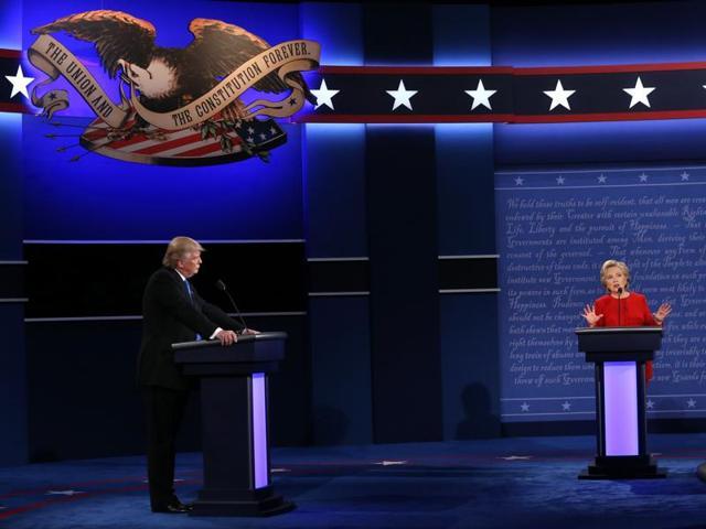 Republican presidential nominee Donald Trump (L) debates Democratic presidential nominee Hillary Clinton during the Presidential Debate at Hofstra University in Hempstead, New York.