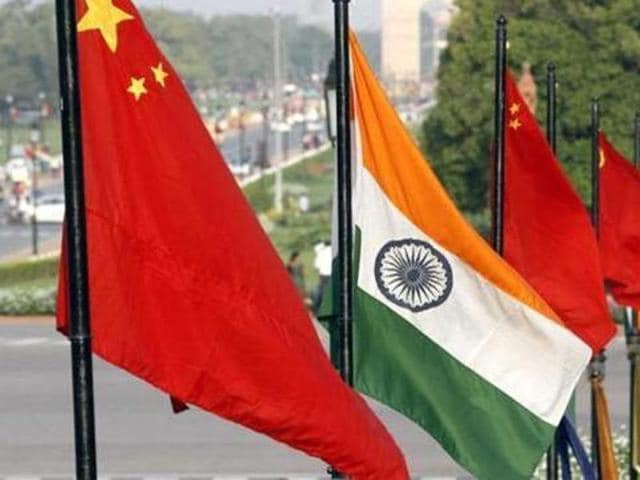 A combination photo of the national flags of India and China.