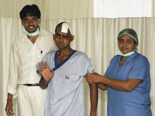 Ikhlaq's son Danish (centre) fell on the ground, and the mob left him thinking he was dead. Danish underwent three surgeries to fix his broken skull.