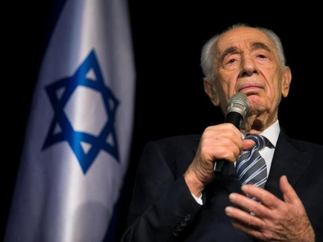 Israel's former president Shimon Peres speaks to the media during a news conference in the southern town of Sderot.