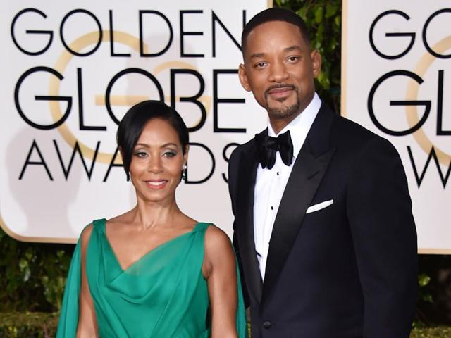 Jada Pinkett Smith, left, and Will Smith arrive at the 73rd annual Golden Globe Awards at the Beverly Hilton Hotel in Beverly Hills, Calif. The couple married on Dec. 31, 1997.