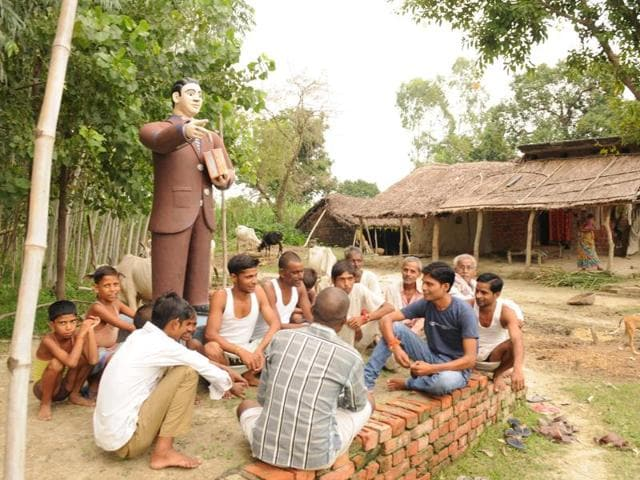 Dalits hold a panchayat meeting near an Ambedkar statue at Deokali village in UP's Lakhimpur Kheri district.