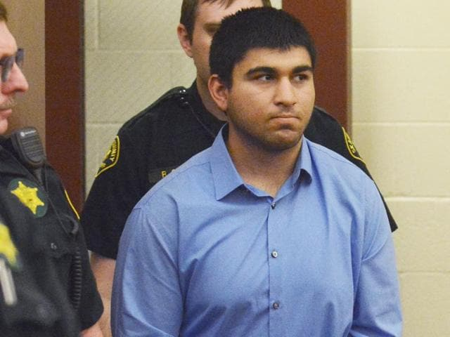 Arcan Cetin is escorted into Skagit County District Court by Skagit County's sheriff's deputies.