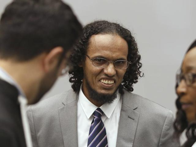 Ahmad Al Faqi Al Mahdi, a Malian jihadi who pleaded guilty to destruction of historic mausoleums in Timbuktu, listens to his defence team as he enters the court room to hear the verdict of the International Criminal Court in The Hague, Netherlands, Tuesday.