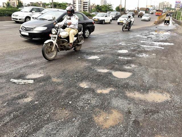 Mumbai,Potholes,Road scam
