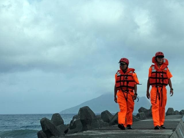 Taiwan Coast Guard personnel patrol the Wushih harbour at Yilan county, eastern Taiwan, as typhoon Megi approaches on Monday. Taiwan evacuated thousands of tourists from outlying islands and set up nearly 100 shelters across the island as it braced for its third typhoon in two weeks.