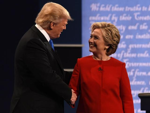 Republican US presidential nominee Donald Trump speaks as Democratic Upresidential nominee Hillary Clinton listens during their first presidential debate at Hofstra University in Hempstead, New York.