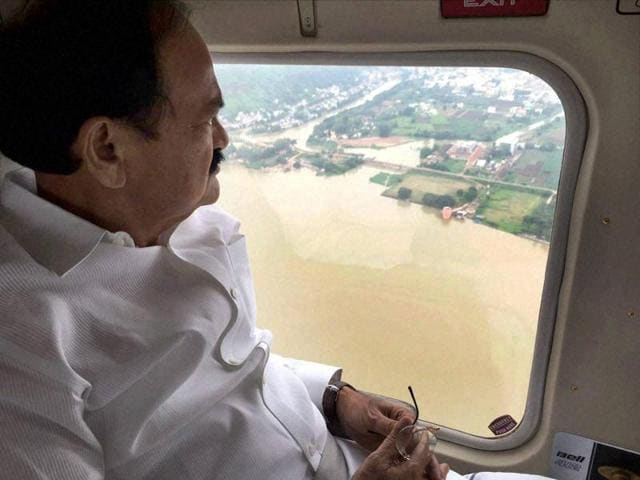 Union minister M Venkaiah Naidu conducts an aerial survey of flood-affected areas in Guntur district of Andhra Pradesh on Tuesday.