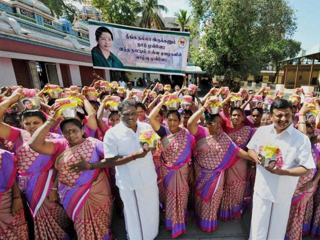 AIADMK  MLAs Amman Arjunan and PRG Arunkumar offer prayers with women party members for the speedy recovery Tamil Nadu chief minister J Jayalalithaa, in Coimbatore.