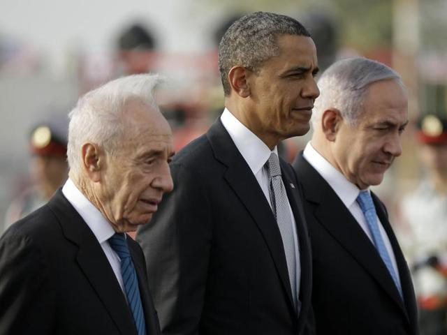 Israel's Shimon Peres (left) and Benjamin Netanyahu (right) with Barack Obama (centre) in March 2013. Peres, a former Israeli president, passed away on September 27, 2016, from a stroke. He was 93.