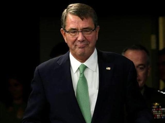 USdefense secretary Ash Carter listens as defence minister Manohar Parrikar speaks during their joint news conference at the Pentagon.