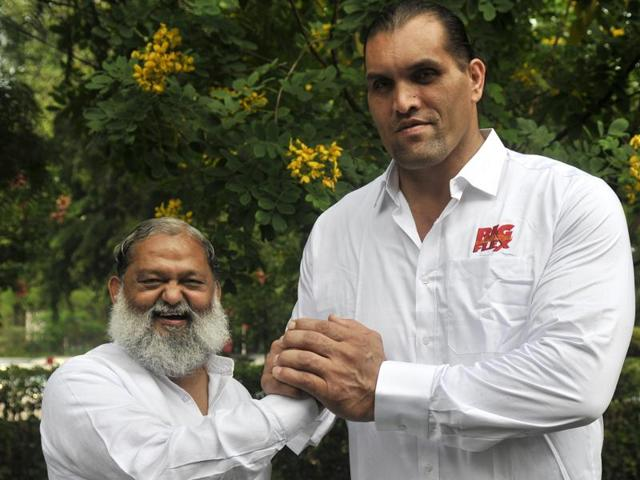 Dalip Singh Rana, or The Great Khali, with Haryana sports minister Anil Vij after an interaction with the media in Chandigarh on Tuesday.