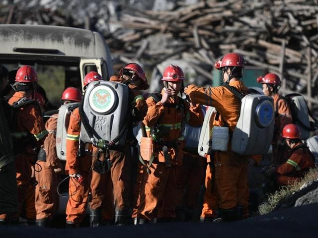 In this photo released by China's Xinhua News Agency, rescuers prepare to enter a coal mine in Shizuishan in northwestern China's Ningxia Hui Autonomous Region on September 28, 2016.