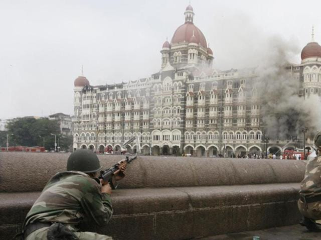 Indian Army soldiers take up position during a gun battle at the Taj Mahal hotel in Mumbai in this November 29, 2008 photo.