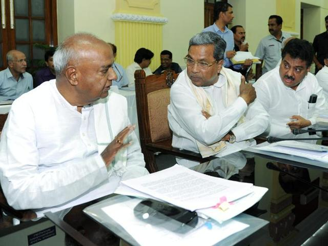Former Prime Minister HD Deve Gowda interacts with Karnataka chief minister Siddaramaiah at an all-party meeting on Cauvery water sharing issue at Vidhan Soudha in Bengaluru.
