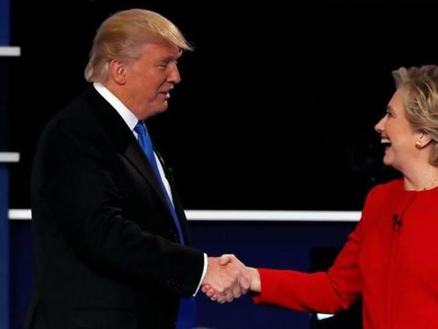 Donald Trump and Hillary Clinton shake hands at the end of their first presidential debate at Hofstra University in Hempstead.