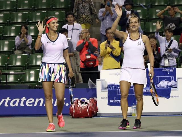 Sania Mirza, left, of India, and her partner Barbora Strycova, of the Czech Republic, at Wuhan Open.(AP Photo)
