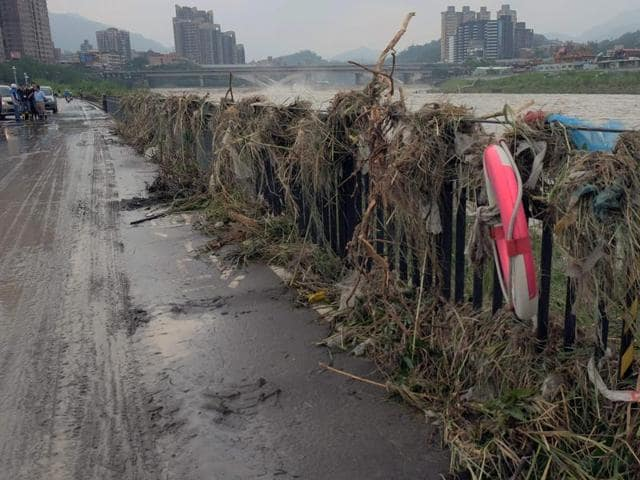 Flood debris covers the banks of the Xindian river in the aftermath of typhoon Megi at Xindian district in New Taipei City.