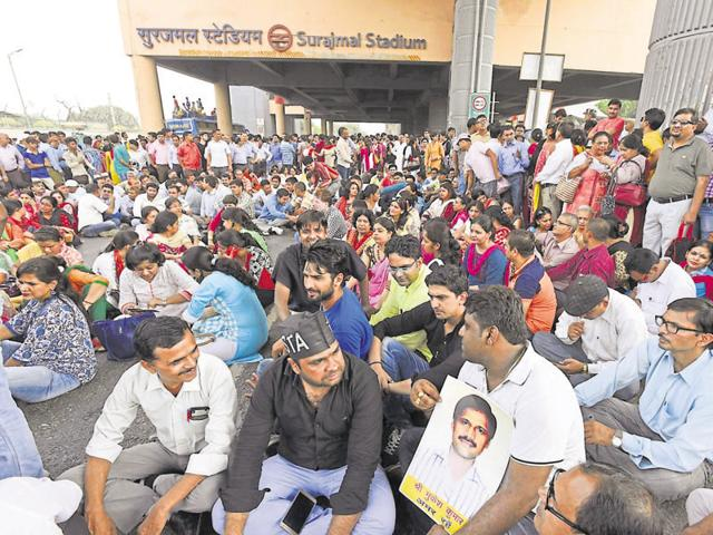 Teachers stage a protest at Surajmal Stadium Metro station on Tuesday.They are demanding improved security, better compensation and snipping powers of the School Management Committee.