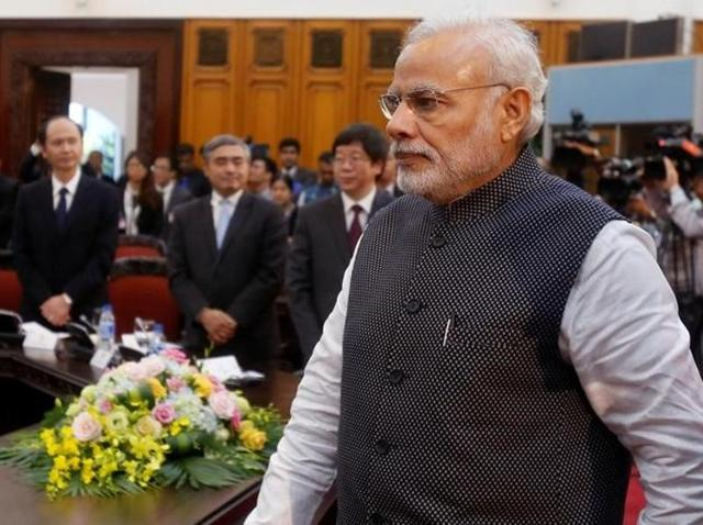US President Barack Obama (right) shakes hands with Prime Minister Narendra Modi prior to a meeting on the sidelines of the Association of Southeast Asian Nations (ASEAN) Summit in Vientiane.