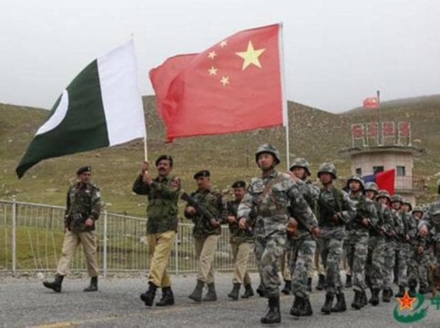 """Chinese and Pakistan troops jointly patrolling the border connecting PoK with Xinjiang region. China's vice-foreign minister Liu Zhenmin said China wants """"relevant parties"""" to resolve the issue through consultation, during an interaction with a Pakistani delegation on Kashmir."""