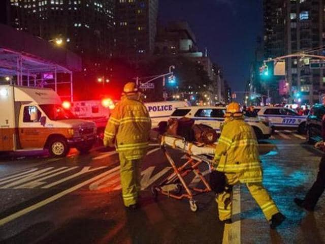 First responders work near the scene of an explosion in Manhattan's Chelsea neighborhood, in New York on September 17, 2016 . Ahmad Rahami is suspected of carrying out the bombings.