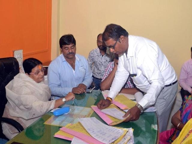 Mayor Malini Gaud inspects official records at Palhar Nagar zonal office of Indore civic body on Wednesday.