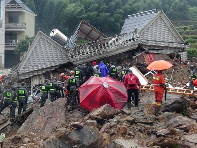 This aerial photo taken on September 29 shows Chinese rescuers searching for survivors at a landslide area in the village of Sucun in Suichang county, east China's Zhejiang province.