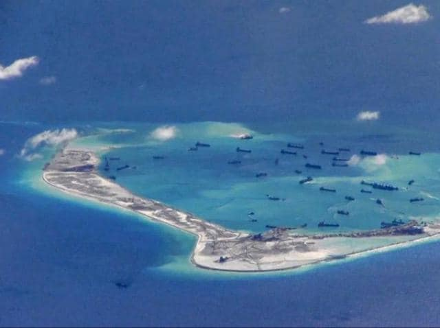 China has warned Japan against 'playing with fire' in the contested waters of the South China Sea.