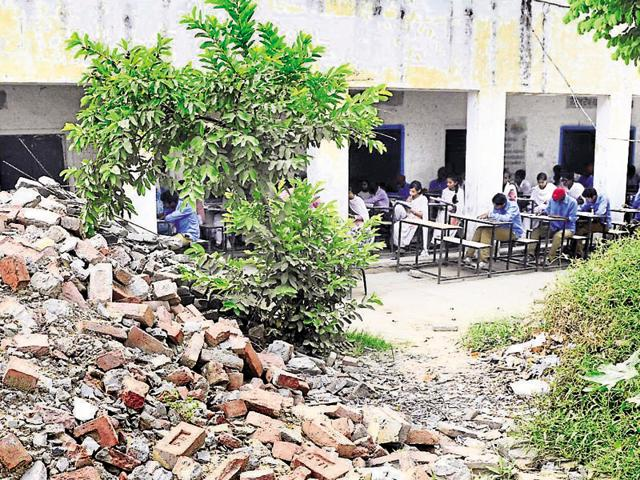 Students of Government Senior Secondary School, Ladowal, are forced to attend their classes in the open.
