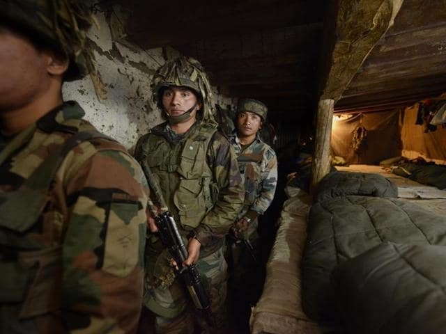 In this file photo, Indian Army soldiers can be seen preparing to move to a forward post along the India-Pakistan border in Shaujian area near Poonch on Wednesday.