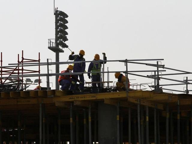 Migrant labourers work at a construction site at the Aspire Zone in Doha, Qatar.