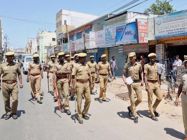Police shooing away protestors during a clash between two groups following Hindu Munnani leader C Sasikumar's murder in Coimbatore last week.(PTI)