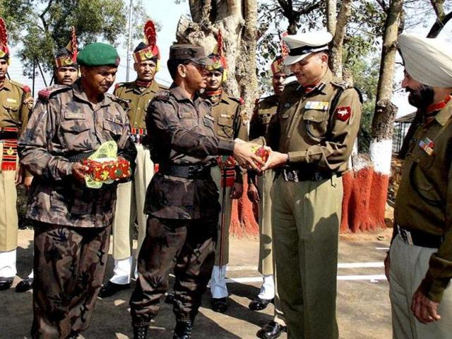 In this 2013 file photo, BSF personnel exchange sweets with Border Guard of Bangladesh on 64th Republic Day at Akhaura India-Bangladesh check-post near Agartala.