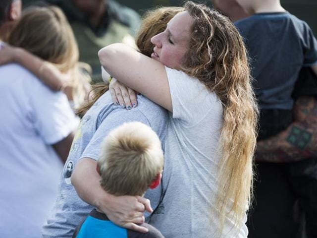 People hug after recovering their children after a shooting at Townville Elementary on Wednesday.
