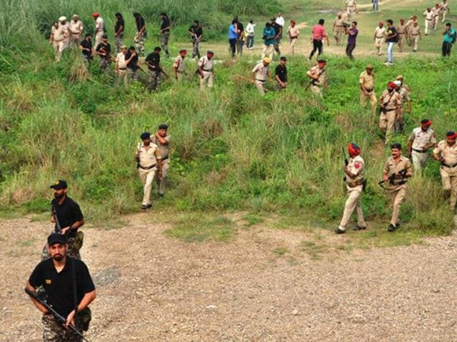 Punjab and Himachal Pradesh police personnel carrying out a joint combing operation in Pathankot region on Wednesday.
