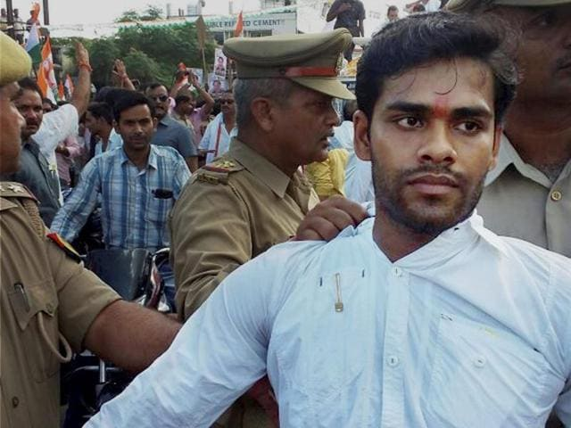 Police arrest Hari Om Mishra who hurled a shoe at Congress vice president Rahul Gandhi during his road show in Sitapur district of Uttar Pradesh.