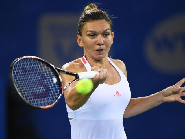 Simona Halep of Romania hits a return shot against Yaroslava Shvedova of Kazakhstan.
