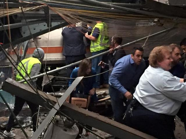 Passengers rush to safety after a New Jersey Transit train crashed in to the platform in Hoboken, New Jersey.
