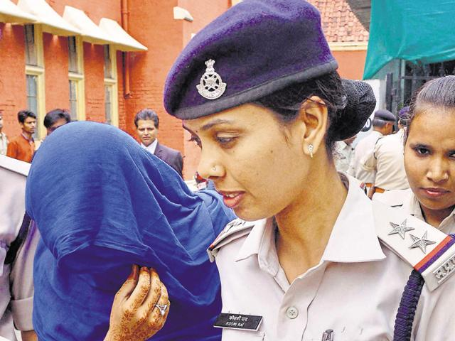 Ritu Ahuja is taken away after a court sentenced her with life term for killing her daughter, in Jabalpur on Wednesday.