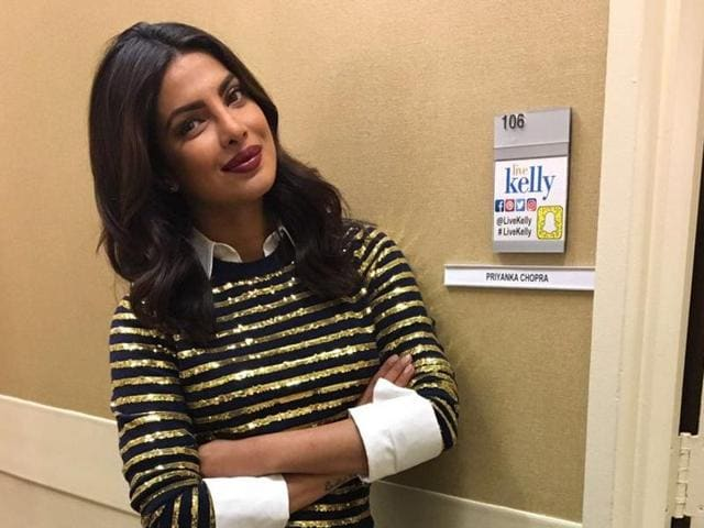 Soaked in excitement about the positive reviews of her ongoing second season of American thriller Quantico, Priyanka looked sizzling in a striped golden shirt and a blue skirt.