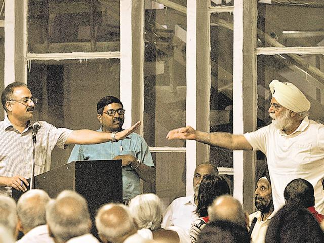 A resident arguing with mayor Arun Sood during a meeting in Sector 38, Chandigarh, on Thursday.