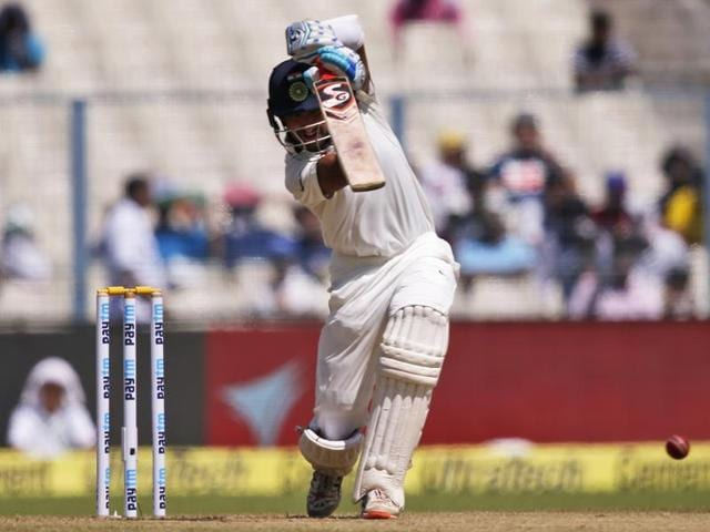 Cheteshwar Pujara drives a ball for a boundary on the first day of the second Test match against New Zealand, in Kolkata on Friday.