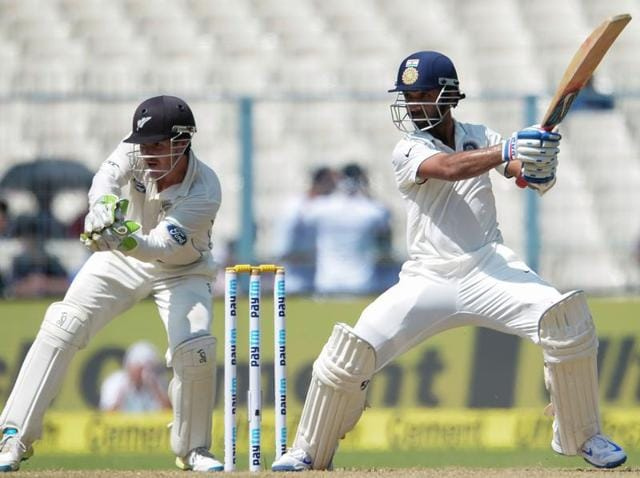 Indian batsman Ajinkya Rahane plays a shot on the first day of the second cricket test match.