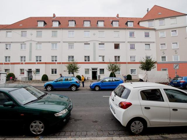 A residential house in the borough of Vahrenwald in Hannover, Germany on Friday. The skeleton of a dead newborn and a living baby have been found in a suitcase inside a flat of the residential house.(AP)