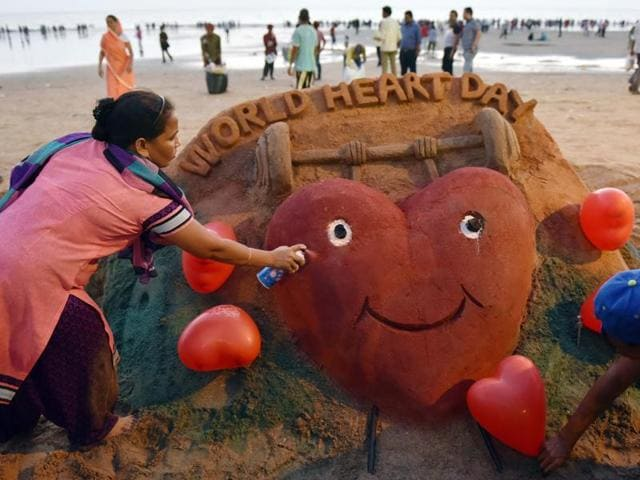 Artist Laxmi Gaud creates sand art on the occasion of World Heart Day at Juhu beach in Mumbai.
