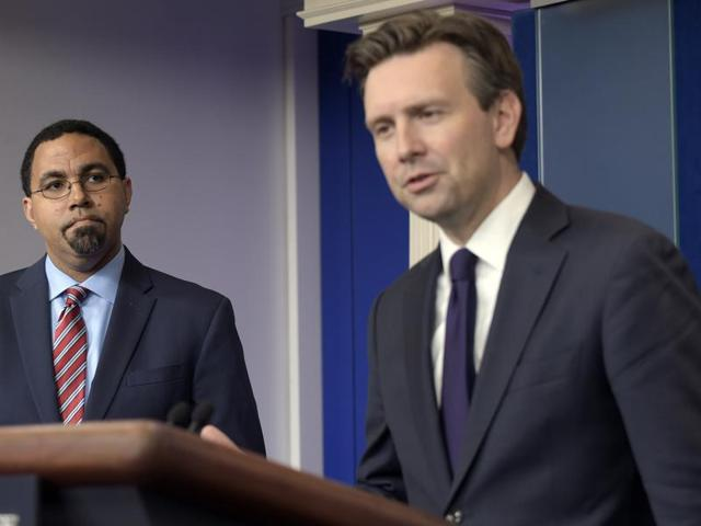 US education secretary John King listens White House press secretary Josh Earnest (right) speaks during a daily briefing at White House in Washington on Thursday.