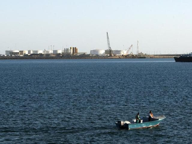 A speed boat passes by oil docks at the port of Kalantari in the city of Chabahar.