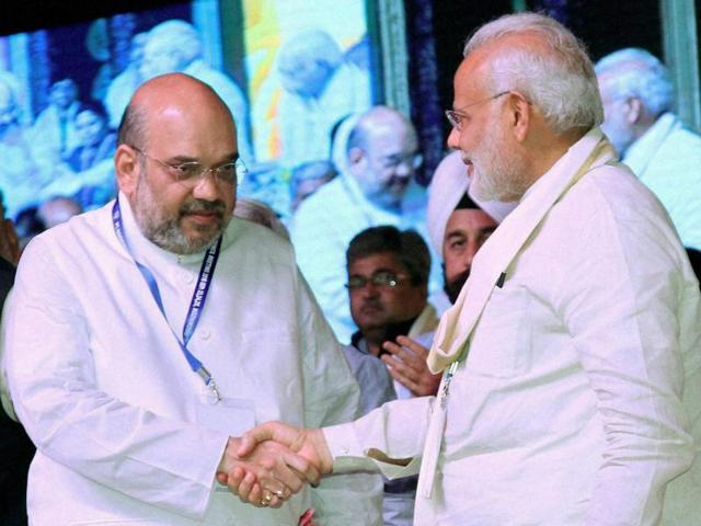 Prime Minister Narendra Modi shakes hands with BJP president Amit Shah during a recent event in Kozhikode.(PTI Photo)
